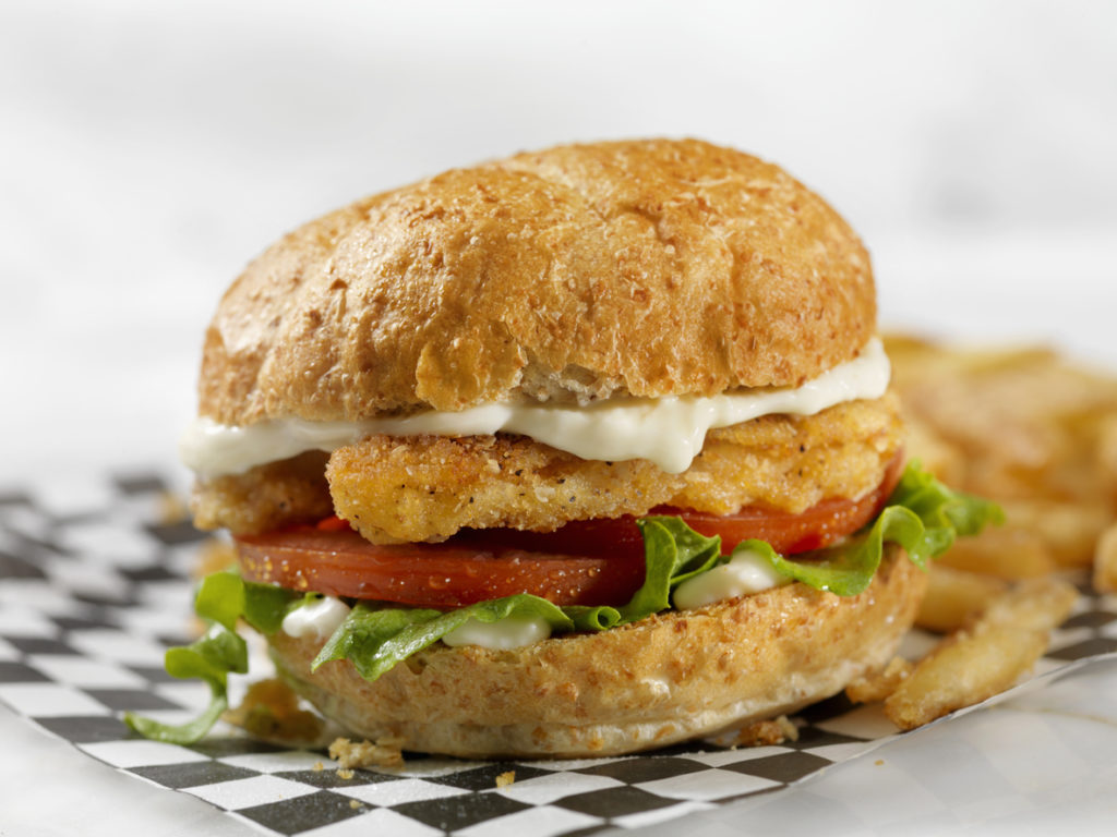 Meatless-Plant Based Protein Chicken Strip Burger on a Whole Wheat Bun with Lettuce Tomato and Mayo