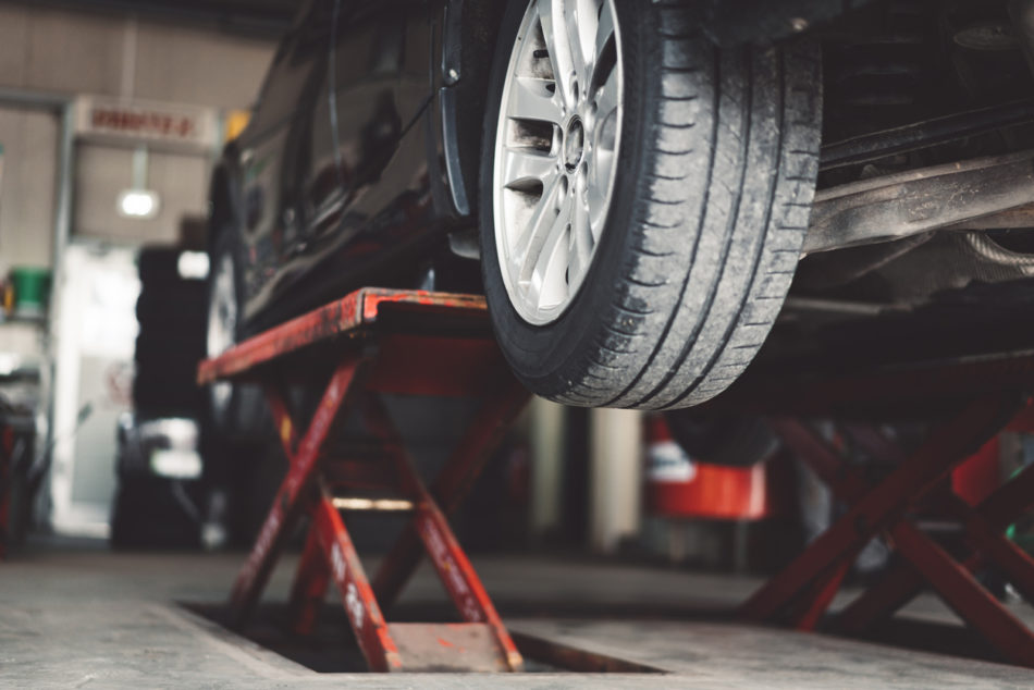 Car lifted in vehicle service department